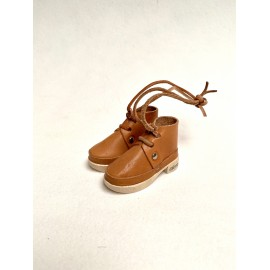 Pair of natural colored clogs